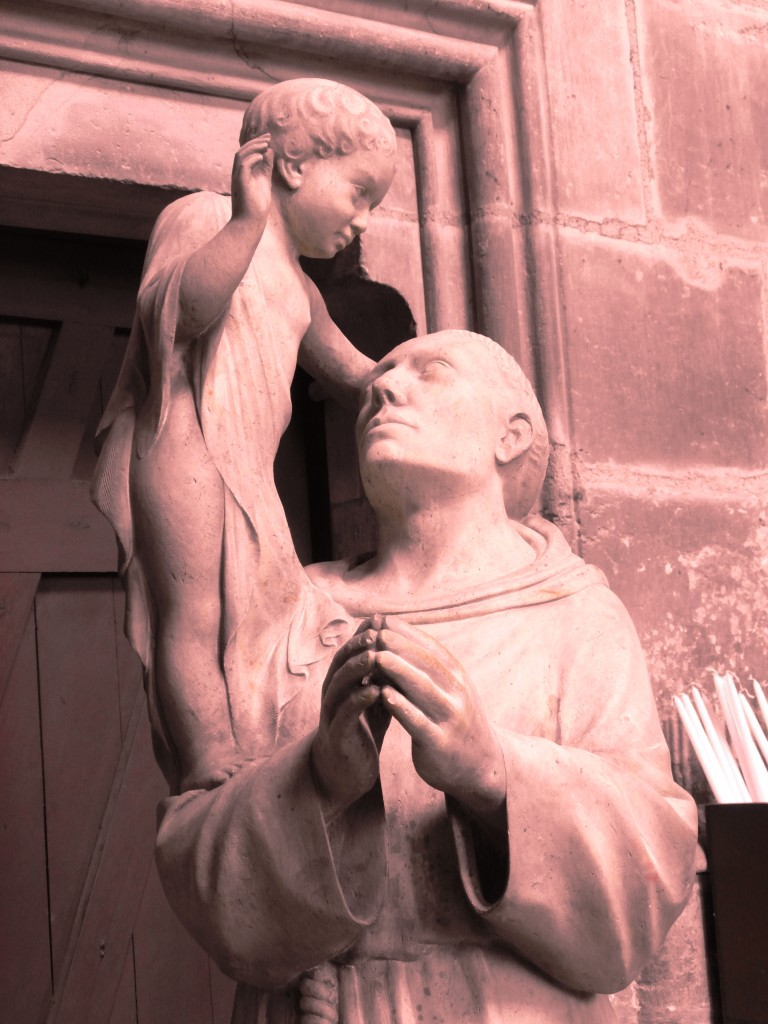 Biddende monnik met engel